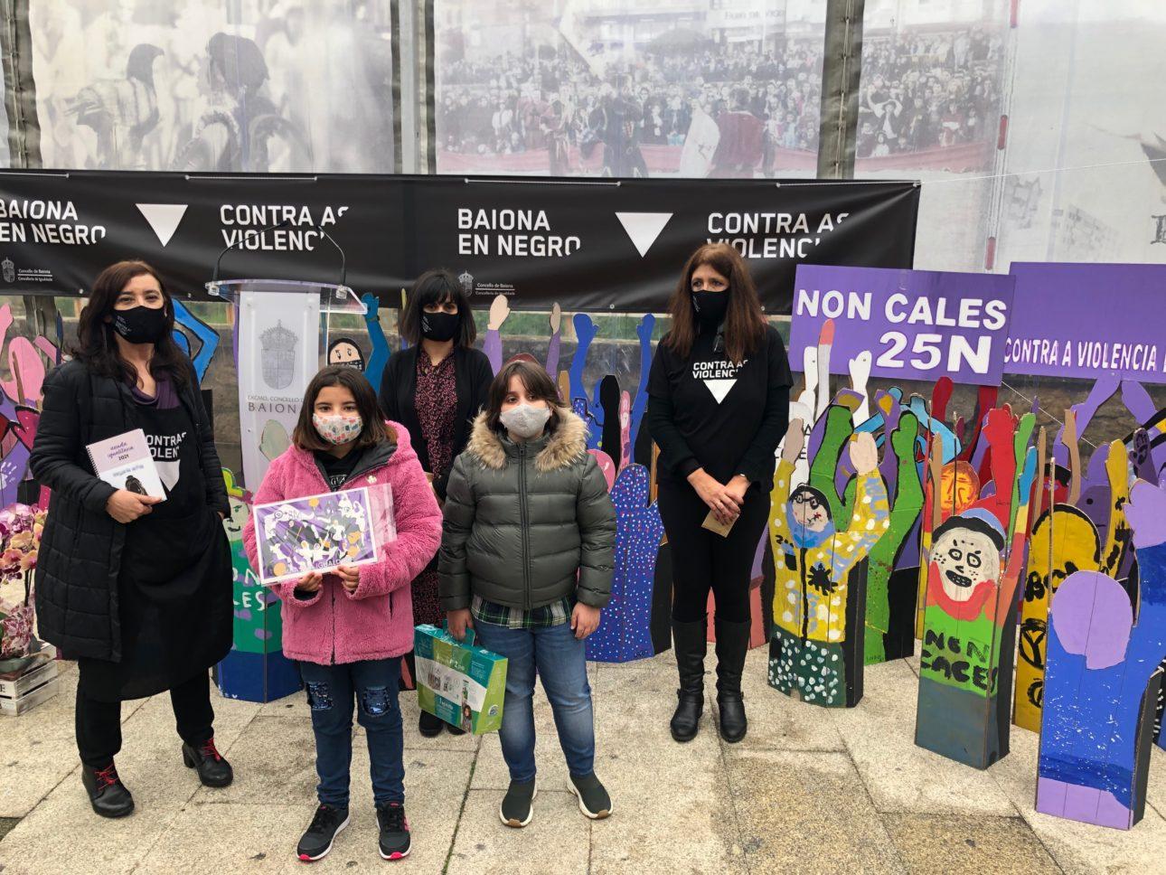 Neno e Nena representantes dos centros educativos que interviron no acto scaled Baiona